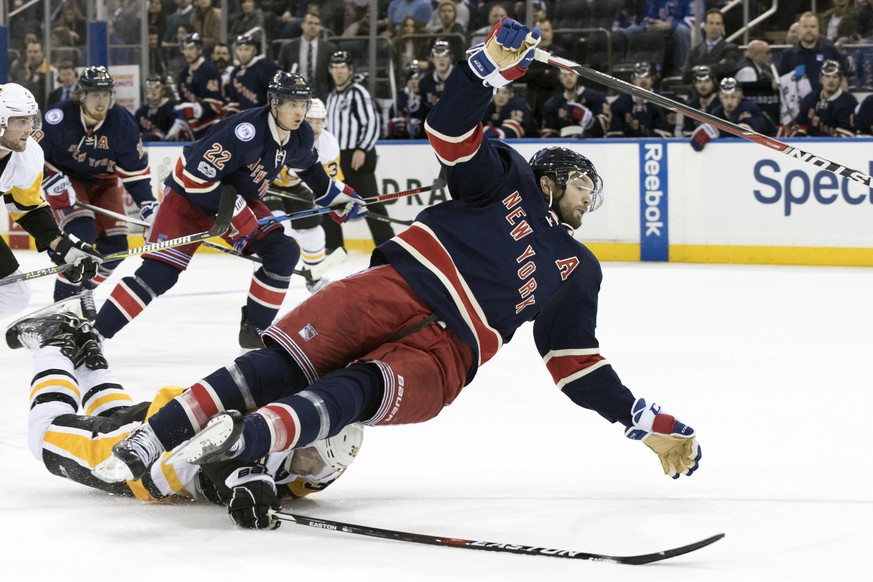 Pittsburgh Penguins defenseman Mark Streit, bottom, trips New York Rangers right wing Rick Nash during the second period of an NHL hockey game, Friday, March 31, 2017, at Madison Square Garden in New York. (AP Photo/Mary Altaffer)