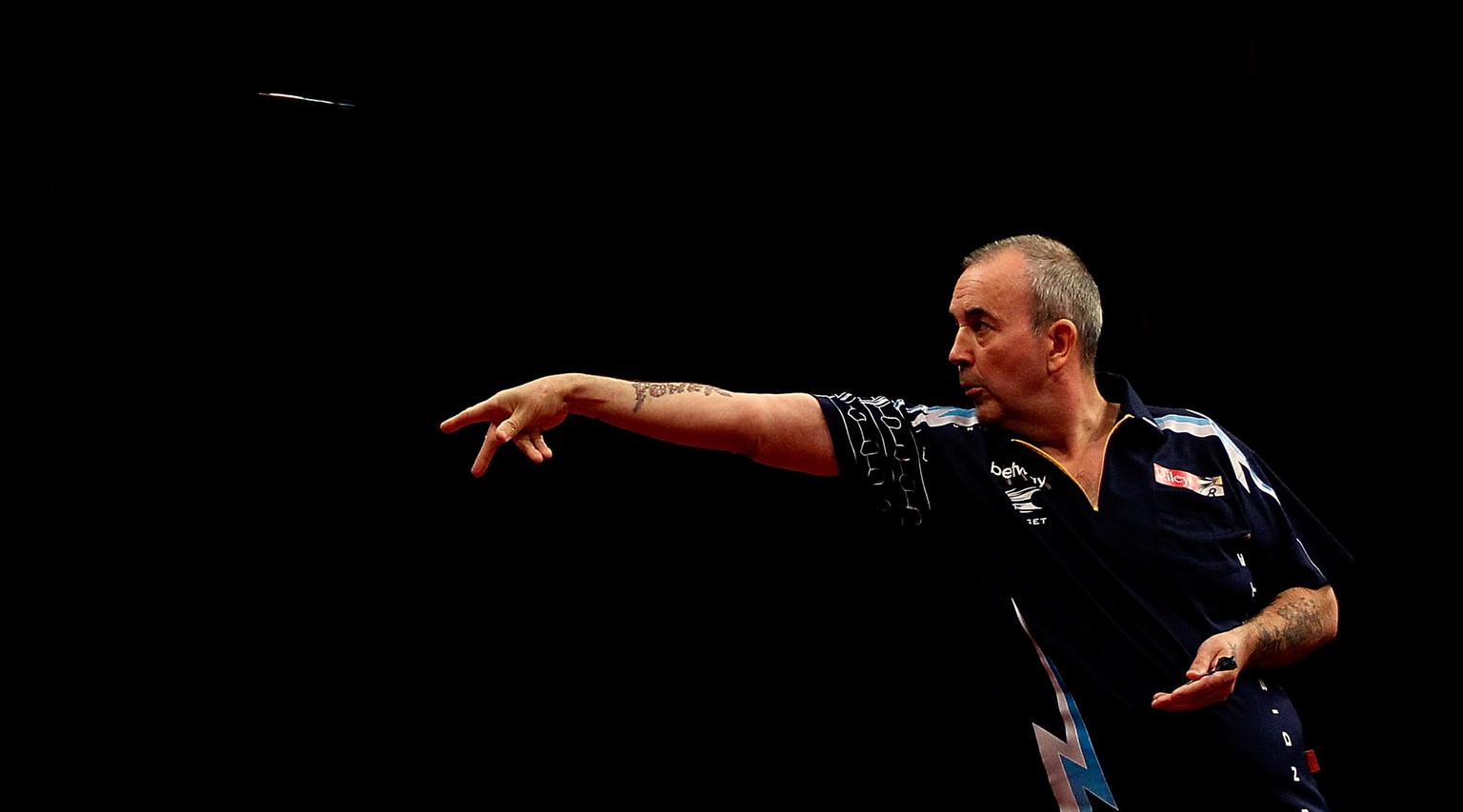 LONDON, ENGLAND - MAY 22:  Phil Taylor of England in action during the McCoys Premier League Darts Play-Offs Semi Final match between Raymond van Barneveld and Phil Taylor at O2 Arena on May 22, 2014 in London, England.  (Photo by Ben Hoskins/Getty Images)