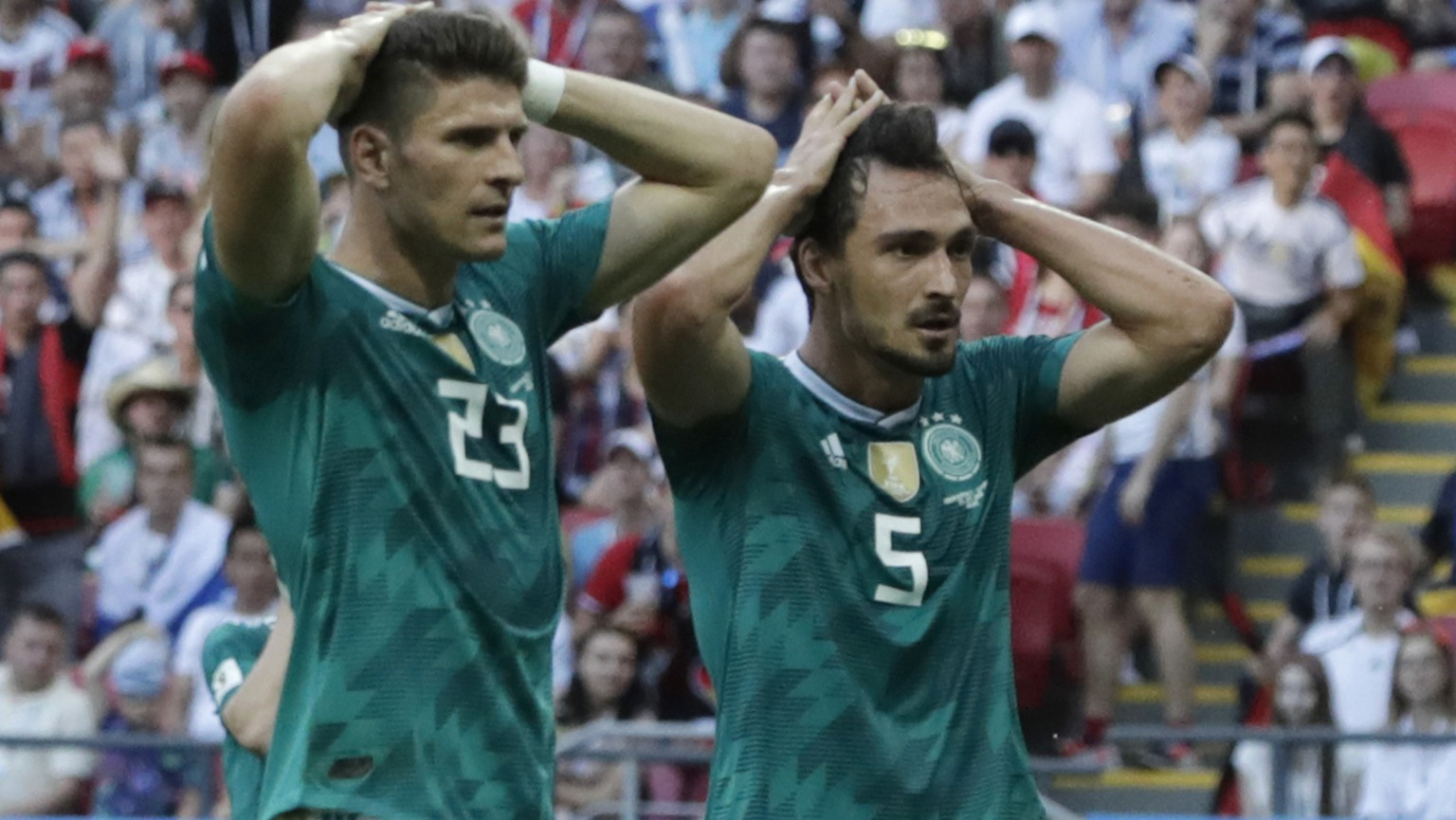 Germany's Mario Gomez, left, and Germany's Mats Hummels, right, hold their heads after failing to score during the group F match between South Korea and Germany, at the 2018 soccer World Cup in the Kazan Arena in Kazan, Russia, Wednesday, June 27, 2018. (AP Photo/Lee Jin-man)