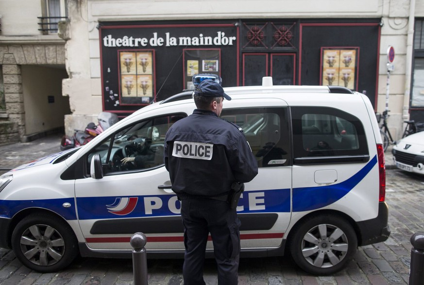 epa04045227 A French Policeman stands guard outside the Theatre de la Main d'Or during a warranted police search on the premises, in Paris, France, 28 January 2014. Controversial French comedian Dieudonne M'Bala M'Bala, who made headlines earlier in the month after his comedy show was banned in several cities across France for its antisimitic content, is now under police investigation for alleged money laundering and fraud.  EPA/IAN LANGSDON