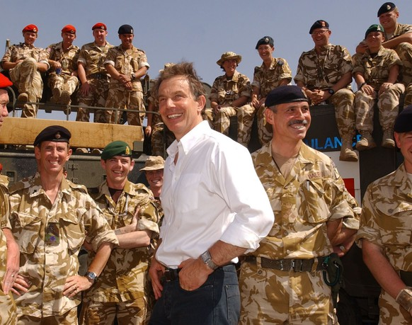 (FILES) In a file picture taken on May 29, 2003 British Prime Minister Tony Blair meets with troops in Basra, Iraq. A further delay in a report into Britain's role in the Iraq war sparked angry claims of a cover-up on January 21, 2015, illustrating the lingering controversy over a conflict in which 179 British soldiers died. Six years after the inquiry started and 12 years on from the 2003 war, its chairman John Chilcot said there was