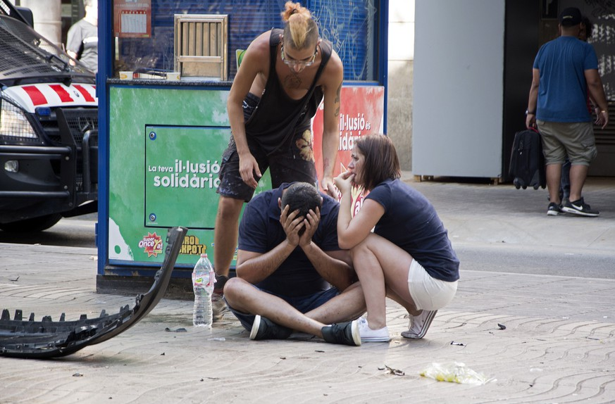 epa06148638 Injured people react after a van crashed into pedestrians in Las Ramblas, downtown Barcelona, Spain, 17 August 2017. According to initial reports a van crashed into a crowd in Barcelona's famous Placa Catalunya square at Las Ramblas area injuring several. Local media report the van driver ran away, metro and train stations were closed. The number of people injured and the reasons behind the incident are not yet known. Official sources have not confirmed that the incident is a terrorist attack.  EPA/David Armengou