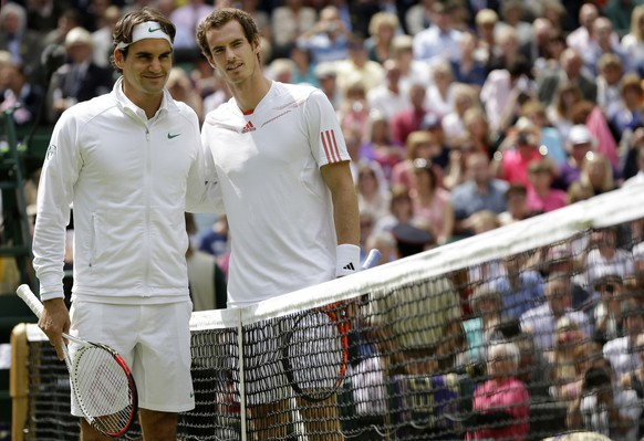 Roger Federer of Switzerland, left, and Andy Murray of Britain pose for photographs before the men's final match at the All England Lawn Tennis Championships at Wimbledon, England, Sunday, July 8, 2012. (AP Photo/Kirsty Wigglesworth)