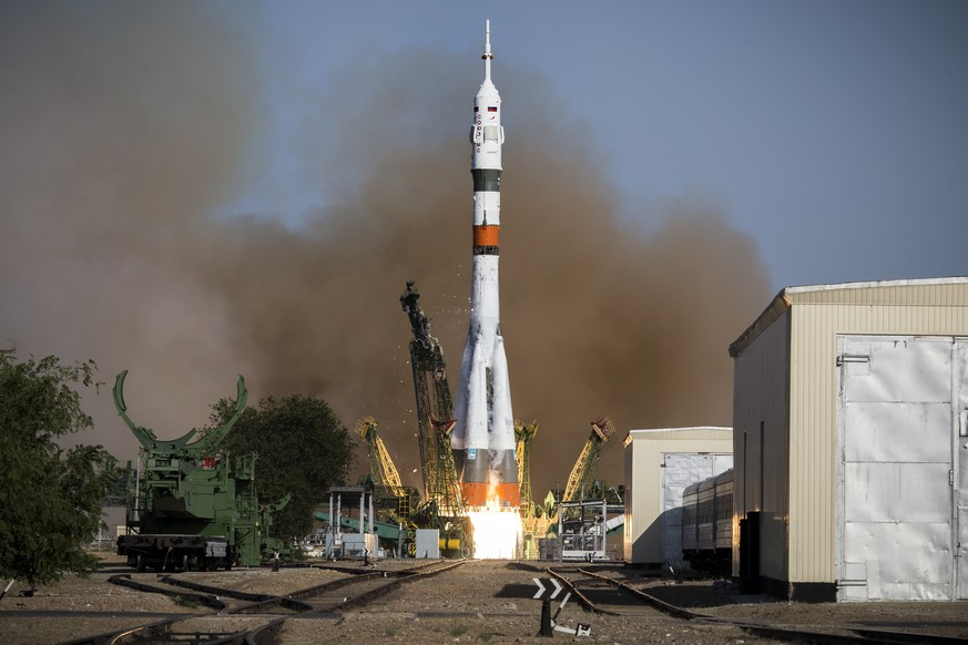 CORRECTING ROCKET NAME AND ADDING ROBOT DETAILS - In this photo taken on Thursday, Aug. 22, 2019, and distributed by Roscosmos Space Agency Press Service, a Soyuz capsule is launched by a new Soyuz 2.1a rocket from the launch pad at Russia's space facility in Baikonur, Kazakhstan.  The new Russian rocket, that is expected to replace the current model sending manned missions into space, blasted off from Kazakhstan on Thursday, carrying a Soyuz capsule with a humanoid robot that will be tested in spaceflight conditions aboard the International Space Station (ISS). Roscosmos Space Agency Press Service photo via AP)