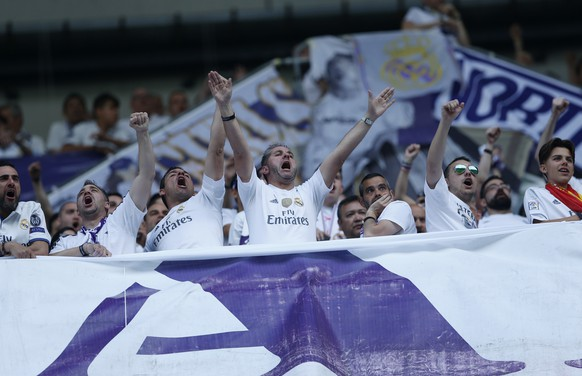 Real Madrid supporters chant prior to the start of a Spanish La Liga soccer match between Real Madrid and Barcelona, dubbed 'el clasico', at the Santiago Bernabeu stadium in Madrid, Spain, Sunday, April 23, 2017. (AP Photo/Francisco Seco)