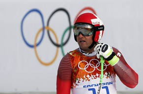Switzerland's Silvan Zurbriggen reacts after the downhill run of the men's alpine skiing super combined training session at the 2014 Sochi Winter Olympics at the Rosa Khutor Alpine Center February 11, 2014. REUTERS/Leonhard Foeger (RUSSIA  - Tags: SPORT SKIING OLYMPICS)