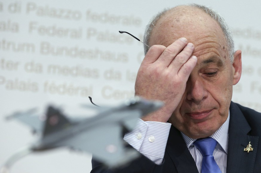 Swiss Defence Minister Ueli Maurer reacts during a news conference on the Gripen fighter jet in Bern February 11, 2014. REUTERS/Thomas Hodel (SWITZERLAND - Tags: POLITICS MILITARY)