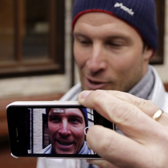 A journalist films Norway's Aksel Lund Svindal with a smartphone during an interview at the Rosa Khutor alpine skiing resort February 17, 2014. Svindal is heading home on Tuesday without competing in his final two races at the Olympic Games after failing to win a medal despite dominating the World Cup season. Graff said Svindal, his country's flagbearer at the opening ceremony, was suffering from allergies and had made the decision after Monday's training. REUTERS/Leonhard Foeger (RUSSIA - Tags: SPORT OLYMPICS SKIING MEDIA)