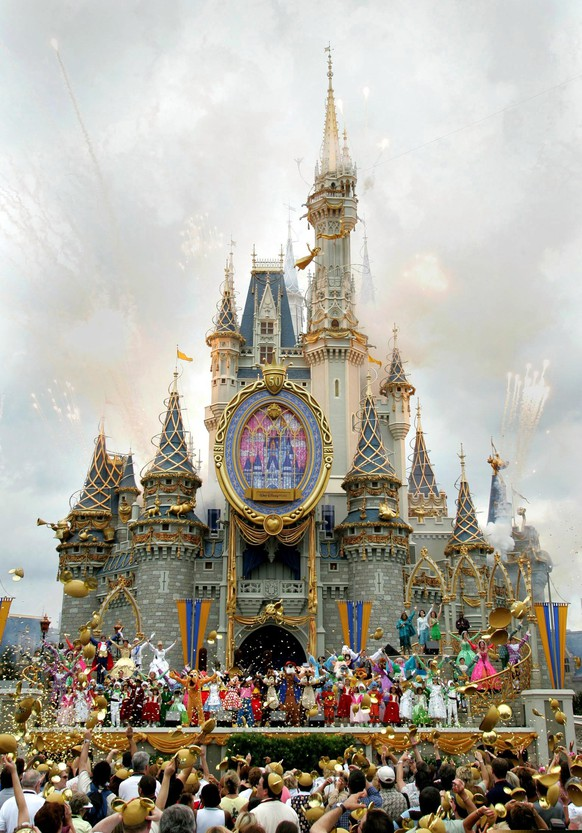 Disney officially starts it's 50th anniversary celebration in front of Cinderella's Castle at the Magic Kingdom in Lake Buena Vista, Florida in this May 5, 2005 file photo. The celebration was conducted simultaneously with Disneyland in Anaheim, California. Walt Disney Co unveiled new single-day ticket prices on February 27, 2016 for the company's U.S. theme parks, switching to a three-tiered system that charges visitors more on the year's busiest days and less during typically slower periods.   REUTERS/Files