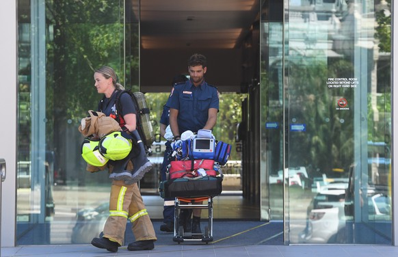 epa07270517 Emergency service personel exit the building where the Korean consulate is located in Melbourne, Australia, 09 January 2019. Staff have been evacuated as emergency crews respond to a number of incidents involving foreign consulates in Melbourne.  EPA/JAMES ROSS AUSTRALIA AND NEW ZEALAND OUT
