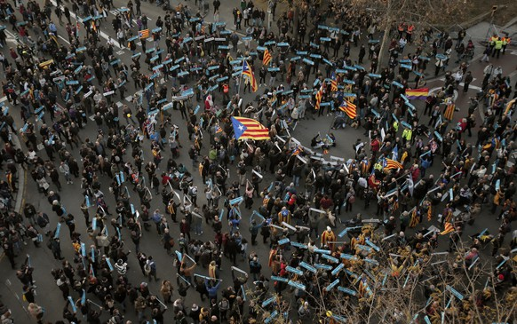 Catalan pro-independence demonstrators gather outside the Camp Nou stadium ahead of a Spanish La Liga soccer match between Barcelona and Real Madrid in Barcelona, Spain, Wednesday, Dec. 18, 2019. Thousands of Catalan separatists are planning to protest around and inside Barcelona's Camp Nou Stadium during Wednesday's match against fierce rival Real Madrid. (AP Photo/Joan Mateu)