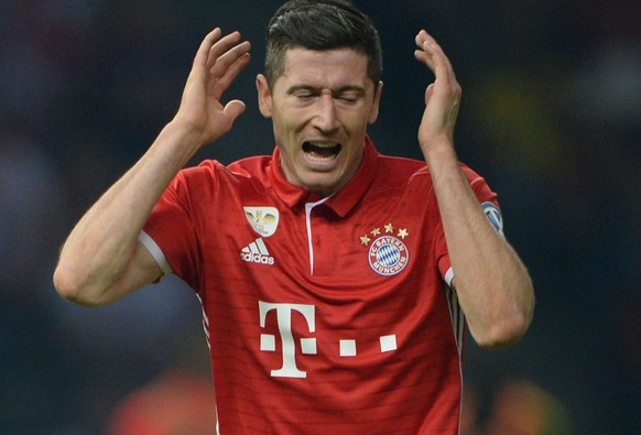 epa05322006 Munich's Robert Lewandowski reacts during the German DFB Cup final soccer match between Bayern Munich and Borussia Dortmund at the Olympic Stadium in Berlin, Germany, 21 May 2016. (EMBARGO CONDITIONS - ATTENTION: The DFB prohibits the utilisation and publication of sequential pictures on the internet and other online media during the match (including half-time). ATTENTION: BLOCKING PERIOD! The DFB permits the further utilisation and publication of the pictures for mobile services (especially MMS) and for DVB-H and DMB only after the end of the match.)  EPA/ANDREAS GEBERT