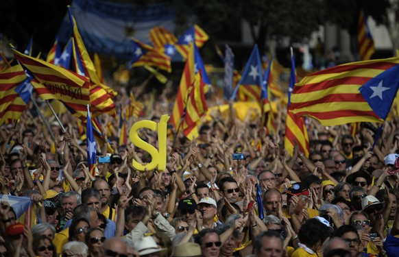 Supporters of the independence of the Catalonia region of Spain, hold estelada or pro independence flags, as they gather in Catalonia square during a rally in Barcelona, Spain, Sunday, Oct. 19, 2014. Thousands of demonstrators crowded a central square in Barcelona during the main campaign event organized by two major pro independence civil society organizations ahead of the vote scheduled for Nov. 9th. Spain's wealthy Catalonia region calls off an independence vote but says an unofficial poll would still be held next month to gauge secessionist sentiment. Separatists in northeastern Catalonia, which has 7.5 million people, have been trying for several years to hold a breakaway vote from Spain to carve out a new Mediterranean nation. (AP Photo/Manu Fernandez)