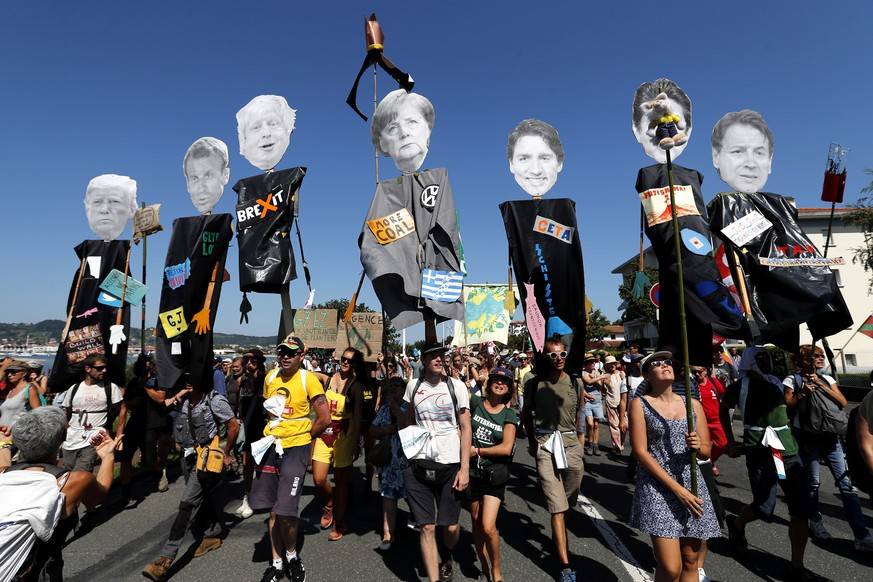 epaselect epa07789723 Protestors hold portraits of representing G7 leaders (L-R), Donald Trump, Emmanuel Macron, Boris Johnson, Angela Merkel, Justin Trudeau, Shinzo Abe and Giuseppe Conte) during a demonstration as part of the G7 Counter-Summit in Hendaye, near Biarritz, France, 24 August 2019, on the opening day of the G7 summit. The G7 Summit runs from 24 to 26 August in Biarritz.  EPA/GUILLAUME HORCAJUELO