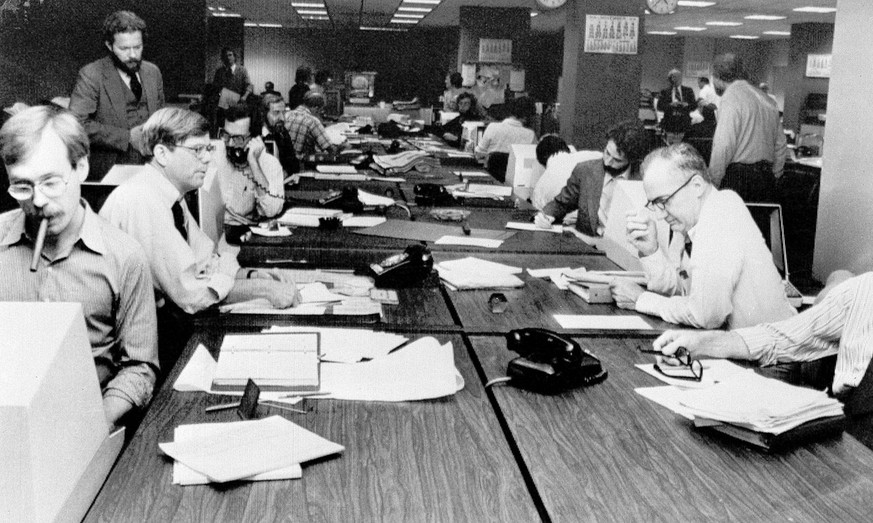 The newsroom at the New York Times is seen as editorial staffers work feverishly to prepare a Monday edition, in this Nov. 5, 1978 photo. A reader-submitted question related to how newsrooms are alerted to breaking news stories is being answered as part of an Associated Press Q&A column called