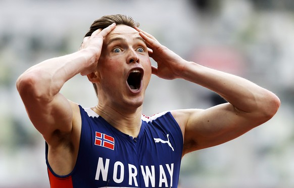 epa09389245 Karsten Warholm of Norway celebrates after winning the Men's 400m Hurdles final at the Athletics events of the Tokyo 2020 Olympic Games at the Olympic Stadium in Tokyo, Japan, 03 August 2021.  EPA/VALDRIN XHEMAJ