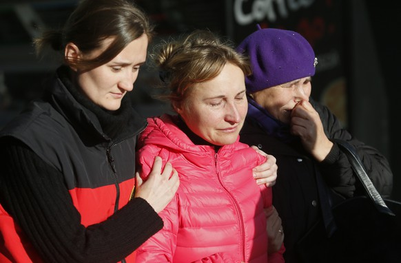 Relatives of the victims of a crashed Russian airliner with 217 passengers and seven crew aboard, help each other as they gathering at Pulkovo airport in St.Petersburg, Russia, Saturday, Oct. 31, 2015. Russia's civil air agency is expected to have a news conference shortly to talk about the Russian Metrojet passenger plane that Egyptian authorities say has crashed in Egypt's Sinai peninsula. (AP Photo/Dmitry Lovetsky)