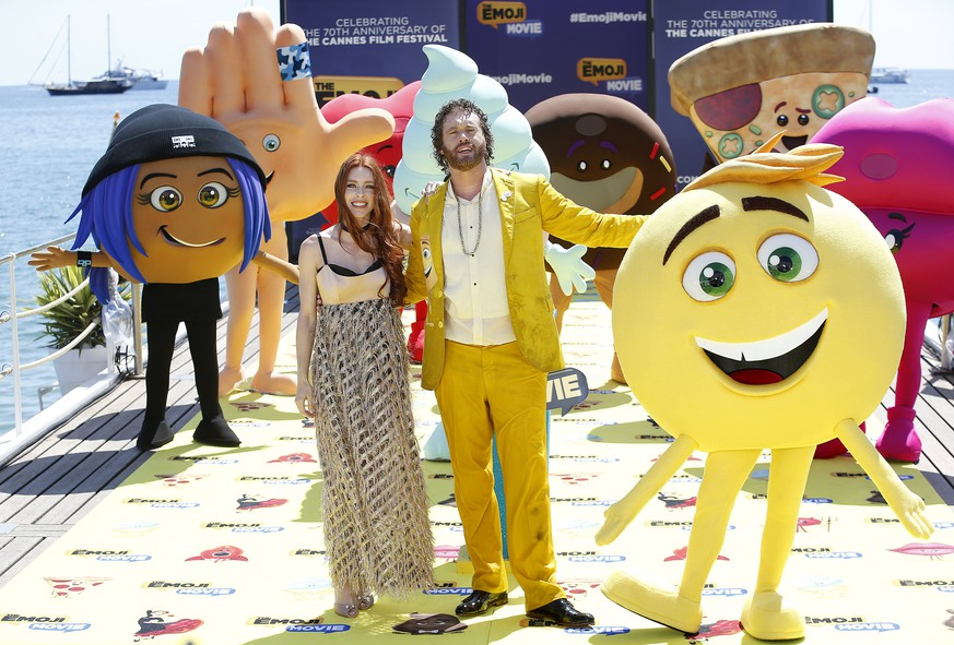 epa05967793 US actor T.J. Miller (R) and his wife Kate (L) pose with Emoji characters during the photocall for 'The Emoji Movie' at the 70th annual Cannes Film Festival, in Cannes, France, 16 May 2017. The film festival will run from 17 to 28 May.  EPA/SEBASTIEN NOGIER