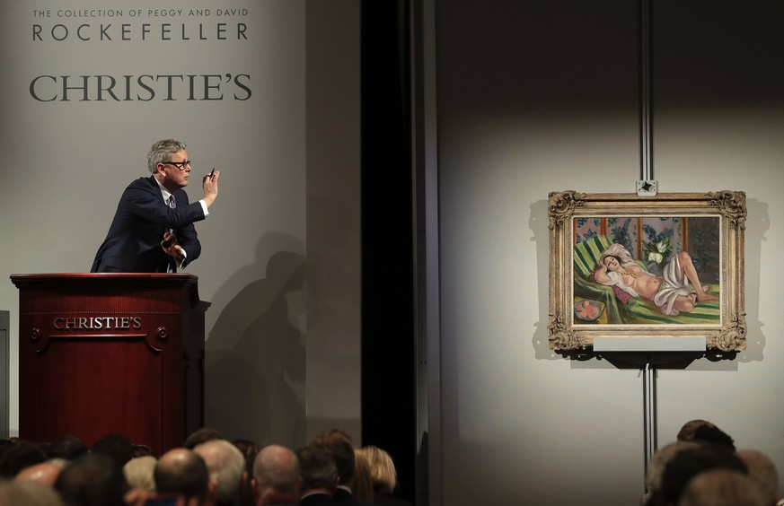 Global president of Christie's Jussi Pylkkanen taps the gavel on the podium for the final sale of Henri Matisse's