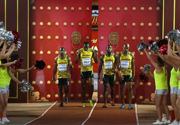 BEIJING, CHINA - AUGUST 29:  Nickel Ashmeade of Jamaica, Asafa Powell of Jamaica, Usain Bolt of Jamaica of Jamaica and Nesta Carter of Jamaica enter the stadium prior to the Men's 4x100 Metres Relay final during day eight of the 15th IAAF World Athletics Championships Beijing 2015 at Beijing National Stadium on August 29, 2015 in Beijing, China.  (Photo by Cameron Spencer/Getty Images)