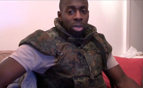 Amedy Coulibaly, one of the three gunmen behind the worst militant attacks in France for decades, declares his allegiance in an unknown location to the Islamic State and urges French Muslims to follow his example, in this still image taken from video January 11, 2015.  In the seven-minute posthumous video, apparently intended for release after the actions, Coulibaly, who staged the attack on a kosher supermarket, said the planned assaults on satirical journal Charlie Hebdo and the Jewish target were justified by French military interventions overseas. Seventeen victims were killed in three days of violence and ended with Friday's dual sieges at a print works outside Paris and the supermarket in the city. A French anti-terrorist police source said there was no doubt it was Coulibaly in the French-language recording.         REUTERS/Social Media via Reuters TV (FRANCE - Tags: CRIME LAW CIVIL UNREST) 
