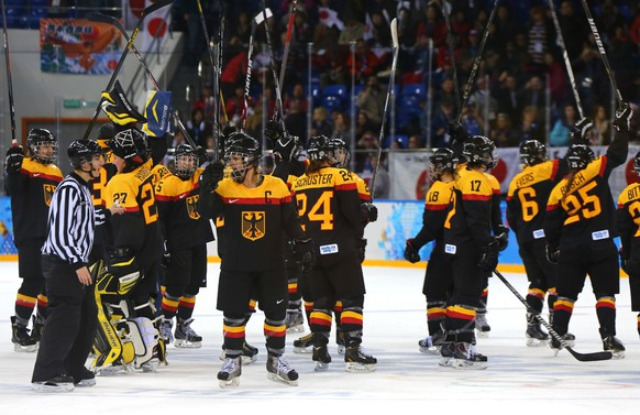 SOCHI, RUSSIA - FEBRUARY 13:  Team Germany celebrates after defeating Japan during the women's Ice Hockey Preliminary Round Group B game on day six of the Sochi 2014 Winter Olympics at Shayba Arena on February 13, 2014 in Sochi, Russia. Germany defeated Japan 4-0. (Photo by Martin Rose/Getty Images)
