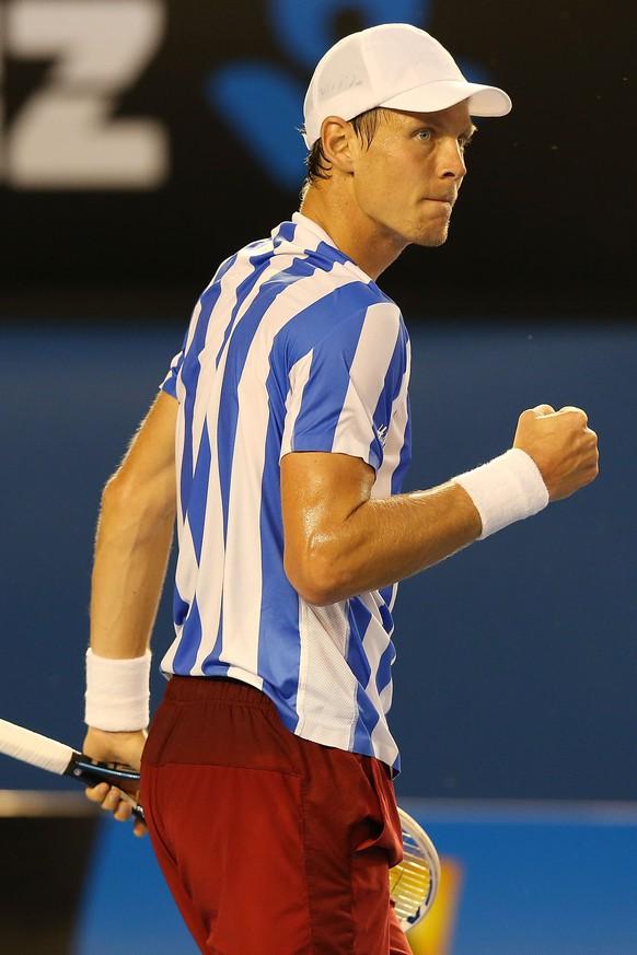 MELBOURNE, AUSTRALIA - JANUARY 23:  Tomas Berdych of the Czech Republic celebrates a point in his semifinal match against Stanislas Wawrinka of Switzerland during day 11 of the 2014 Australian Open at Melbourne Park on January 23, 2014 in Melbourne, Australia.  (Photo by Michael Dodge/Getty Images)