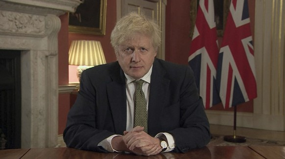 In this image taken from video, Britain's Prime Minister Boris Johnson makes a televised address to the nation from 10 Downing Street, London, Monday Jan. 4, 2021, setting out new emergency measures to control the spread of coronavirus in England. (Pool via AP)