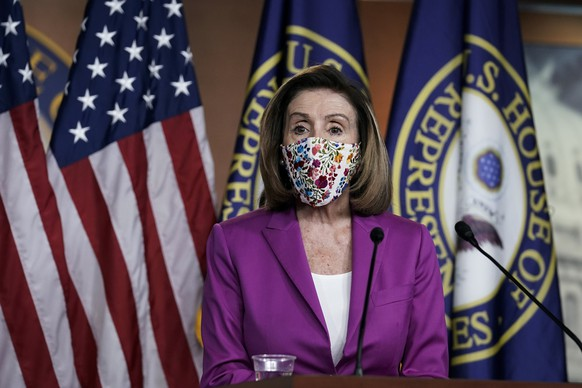 Speaker of the House Nancy Pelosi, D-Calif., holds a news conference on the day after violent protesters loyal to President Donald Trump stormed the U.S. Congress, at the Capitol in Washington, Thursday, Jan. 7, 2021. (AP Photo/J. Scott Applewhite) Nancy Pelosi
