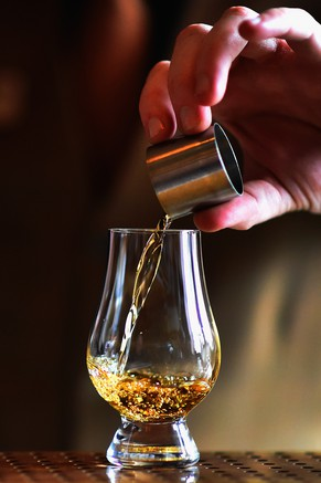 EDINBURGH, SCOTLAND - SEPTEMBER 03:  A members of the staff pours whisky into a glass at The Scotch Whisky Experience on September 3, 2015 in Edinburgh,Scotland.Plans to introduce a minimum unit price for alcohol in Scotland risk infringing EU rules on free trade, according to an initial ruling by Europe's top court.  (Photo by Jeff J Mitchell/Getty Images)