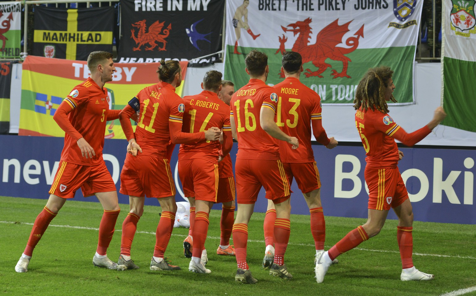 Wales' players celebrate after scoring the opening goal during the Euro 2020 group E qualifying soccer match between Wales and Azerbaijan at the Olympic stadium in Baku, Azerbaijan, Saturday Nov. 16, 2019. (AP Photo/Aziz Karimov)