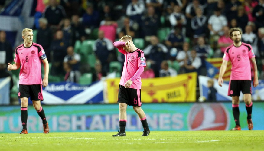 Scotland's Barry Bannan, center, reacts after Slovenia scored their second goal during the World Cup Group F qualifying soccer match between Slovenia and Scotland, at the Stozice stadium in Ljubljana, Slovenia, Sunday, Oct. 8, 2017. (AP Photo/Darko Bandic)