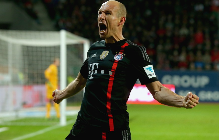AUGSBURG, GERMANY - DECEMBER 13:  Arjen Robben of Muenchen celebrates scoring the second team goal during the Bundesliga match between FC Augsburg and FC Bayern Muenchen at SGL Arena on December 13, 2014 in Augsburg, Germany.  (Photo by Alexander Hassenstein/Bongarts/Getty Images)