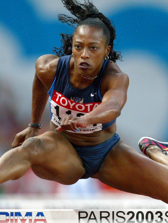 Gail Devers of the United States competes in a Women's 100 meters hurdles semi final at the World Athletics Championships at the Stade de France in Saint Denis, north of Paris Tuesday Aug. 26, 2003. Devers failed to make the final. (AP Photo/Thomas Kienzle)