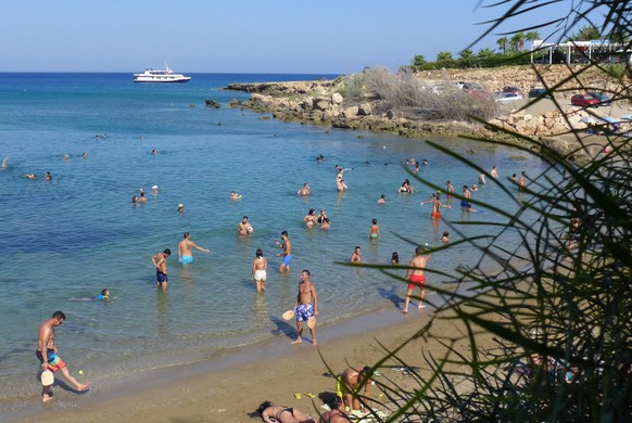 epa06950482 Tourists and locals enjoy the sea during a warm day at Sirina Bay in the southeastern coastal resort of Protaras, Cyprus, 15 August 2018. The Meteorological Services announced that Cyprus will be experiencing a heat-wave like conditions with temperatures expected to surpass 40 degrees Celsius in the coming days.  EPA/KATIA CHRISTODOULOU