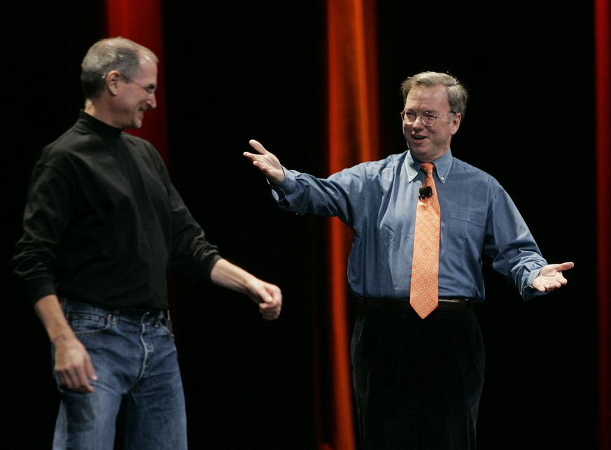 Apple CEO Steve Jobs, left, and Google CEO Eric Schmidt, right, smile as they introduce the iPhone during Jobs' keynote address at MacWorld Conference & Expo in San Francisco, Tuesday, Jan. 9, 2007. (AP Photo/Paul Sakuma)