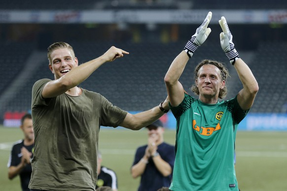 YB's goalkeepers Marco Woelfli, right, and David von Ballmoos, left, celebrate after the UEFA Champions League third qualifying round, second leg match between Switzerland's BSC Young Boys and Ukraine's Dynamo Kiev, in the Stade de Suisse in Bern, Switzerland, Wednesday, August 2, 2017. (KEYSTONE/Peter Klaunzer)