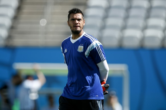 Argentina's goalkeeper Sergio Romero arrives for a training session at Itaquerao Stadium in Sao Paulo, Brazil, Monday, June 30, 2014. On Tuesday, Argentina will face Switzerland in their next World Cup soccer match.  (AP Photo/Victor R. Caivano)