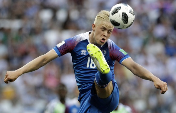 Iceland's Hordur Magnusson goes for the ball during the group D match between Nigeria and Iceland at the 2018 soccer World Cup in the Volgograd Arena in Volgograd, Russia, Friday, June 22, 2018. (AP Photo/Andrew Medichini)