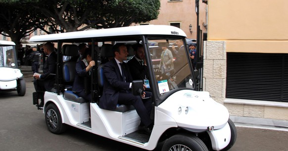 epa05991834 French President Emmanuel Macron (R) sits on a golf cart on the way to vist the Ancient Greek Theater of Taormina on the sideline of the G7 Summit in Taormina, Sicily island, Italy, 26 May 2017. Heads of States and of Governments of the G7, the group of most industrialized economies, plus the European Union, meet in Taormina, Italy, from 26 to 27 May 2017 for a summit titled 'Building the Foundations of Renewed Trust'.  EPA/SARO LAGANA