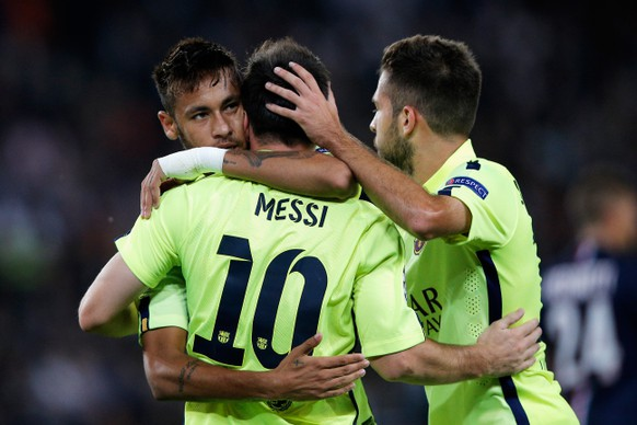 PARIS, FRANCE - SEPTEMBER 30:  Lionel Messi of Barcelona celebrates scoring his teams first goal of the game with Neymar (L) and Jordi Alba (R) during the Group F UEFA Champions League match between Paris Saint-Germain v FC Barcelona held at Parc des Princes on September 30, 2014 in Paris, France.  (Photo by Dean Mouhtaropoulos/Getty Images)