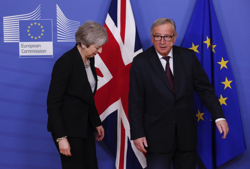 epa07383415 British Prime Minister Theresa May (L) is welcomed by European commission President Jean-Claude Juncker (R) ahead to a meeting on Brexit in Brussels, Belgium, 20 February 2019. May is in Brussels to discuss Brexit and related issues.  EPA/OLIVIER HOSLET