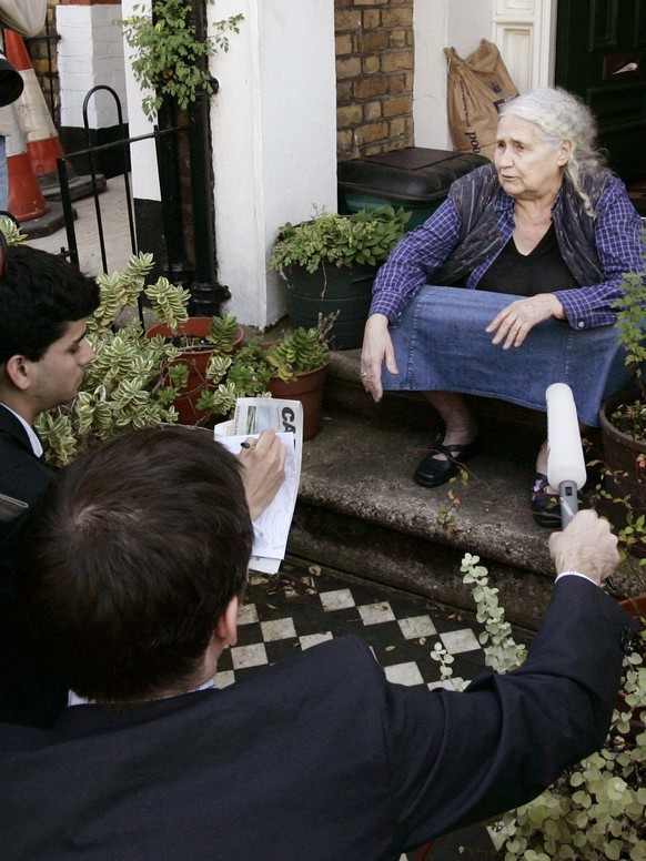 FILE - In this Thursday Oct. 11, 2007 file photo, British writer Doris Lessing talks to members of the media, outside her home in north London after being announced as the winner of that year's Nobel Prize in Literature. At 87, she was the oldest person to win the prestigious award. This year's winner is set to be announced on Thursday, Oct. 5, 2017. (AP Photo/Lefteris Pitarakis, File)