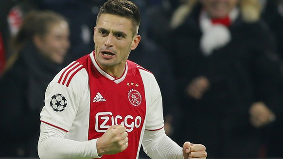Ajax's Dusan Tadic celebrates after scoring his side's second goal during the Champions League group E soccer match between Ajax and FC Bayern Munich at the Johan Cruyff Arena in Amsterdam, Netherlands, Wednesday, Dec. 12, 2018. (AP Photo/Peter Dejong)