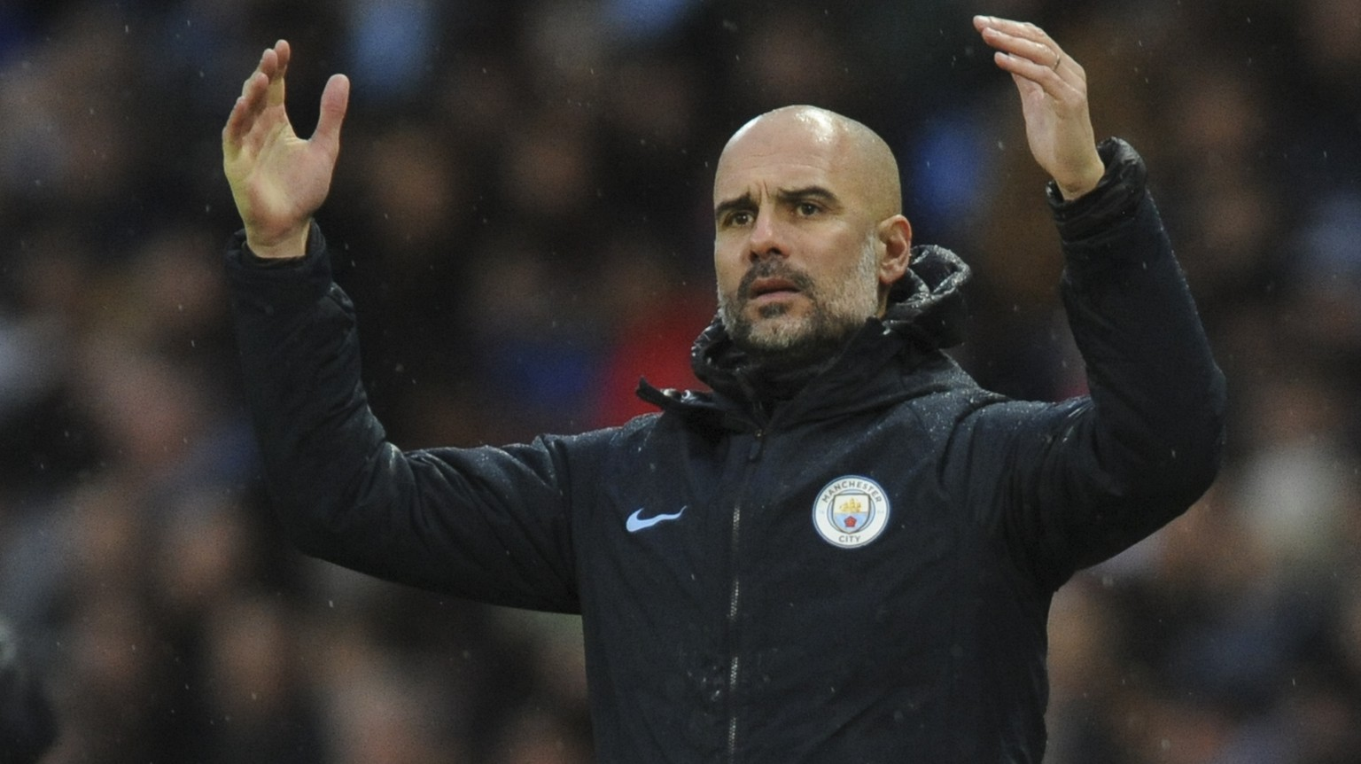 Manchester City manager Josep Guardiola reacts during the FA Cup 4th round soccer match between Manchester City and Burnley at Etihad stadium in Manchester, England, Saturday, Jan. 26, 2019. (AP Photo/Rui Vieira)