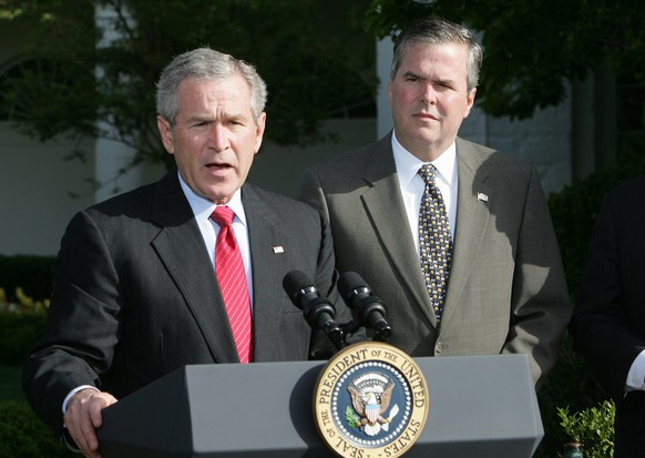 FILE - In this April 19, 2006 file photo, President George W. Bush, accompanied by his brother, then-Fla. Gov. Jeb Bush, speaks on the South Lawn at the White House in Washington. The question for Jeb Bush, as it had before and is sure to again, came during a meeting with prospective donors. At a table of Republican donors who helped pay for 2012 GOP presidential nominee Mitt Romney's campaign, one wanted to know: How does the former Florida governor plan to distinguish himself from his brother, former President George W. Bush?  (AP Photo/Ron Edmonds, File)