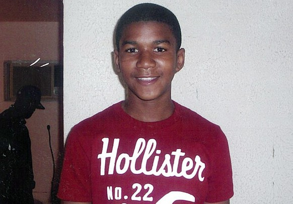 "FILE - This undated file family photo shows Trayvon Martin. Trayvon, 17, was slain in a 2012 shooting in Sanford, Fla., by neighborhood crime-watch captain George Zimmerman. The Goodman Theatre is the latest company to join a national initiative staging a night of short plays about the killing of Trayvon Martin. The Goodman will present six 10-minute works by Marcus Gardley, Tala Manassah, Mona Mansour, Winter Miller, Dominique Morisseau, Dan O'Brien, Quetzel Flores and A. Rey Pamatmat as part of a March 3 production of ""Facing Our Truth: Short Plays on Trayvon Martin, Race and Privilege."" (AP Photo/Martin Family, File)"