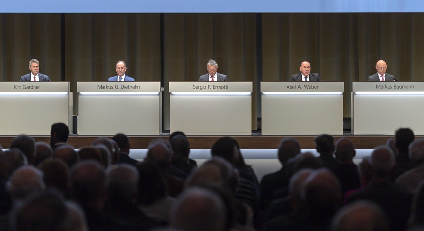 Kirt Gardner, Chief Financial Officer, Markus U. Diethelm, Group General Counsel, Sergio P. Ermotti, Group Chief Executive Officer, Axel A. Weber, Chairman of the Board of Directors, and Markus Baumann, Group Secretary, from left, pictured during the general assembly of the UBS in Basel, Switzerland, on Thursday, May 2, 2019. (Georgios Kefalas/Keystone via AP)