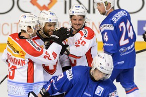 From left behind: Switzerland's Simon Bodenmann, Switzerland's Thomas Ruefenacht and Switzerland's Dino Wieser celebrates the second goal behind France's Yohann Auvitu, center in blue, and France's Julien Desrosiers, right, during a friendly ice hockey game between France and Switzerland, at the ice stadium Pole Sud, in Grenoble, France, Friday, April 24, 2015. (KEYSTONE/Laurent Gillieron)