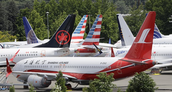 Dozens of grounded Boeing 737 MAX airplanes crowd a parking area adjacent to Boeing Field Thursday, June 27, 2019, in Seattle. A new software problem has been found in the troubled Boeing 737 Max that could push the plane's nose down automatically, and fixing the flaw is almost certain to further delay the plane's return to flying after two deadly crashes. Boeing said Wednesday, June 26, 2019, that the FAA